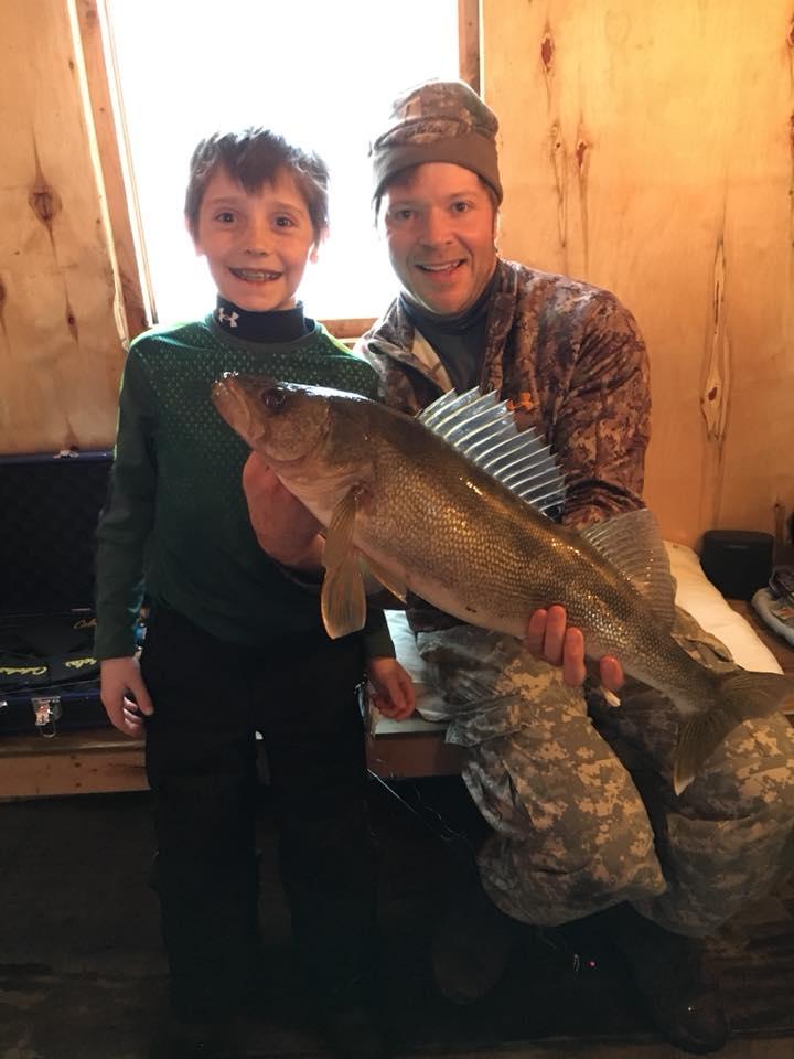 Ten year old with 29 inch walleye.jpg